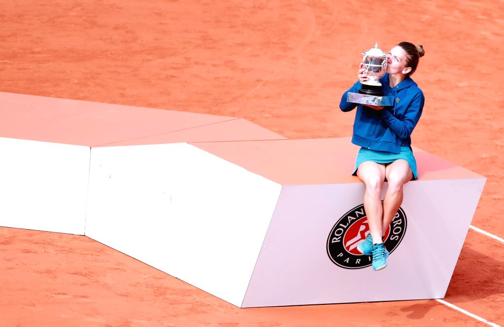 PARIS, June 10, 2018 - Simona Halep of Romania kisses the trophy after the women's singles final against Sloane Stephens of the United States at the French Open Tennis Tournament 2018 in Paris, ...
