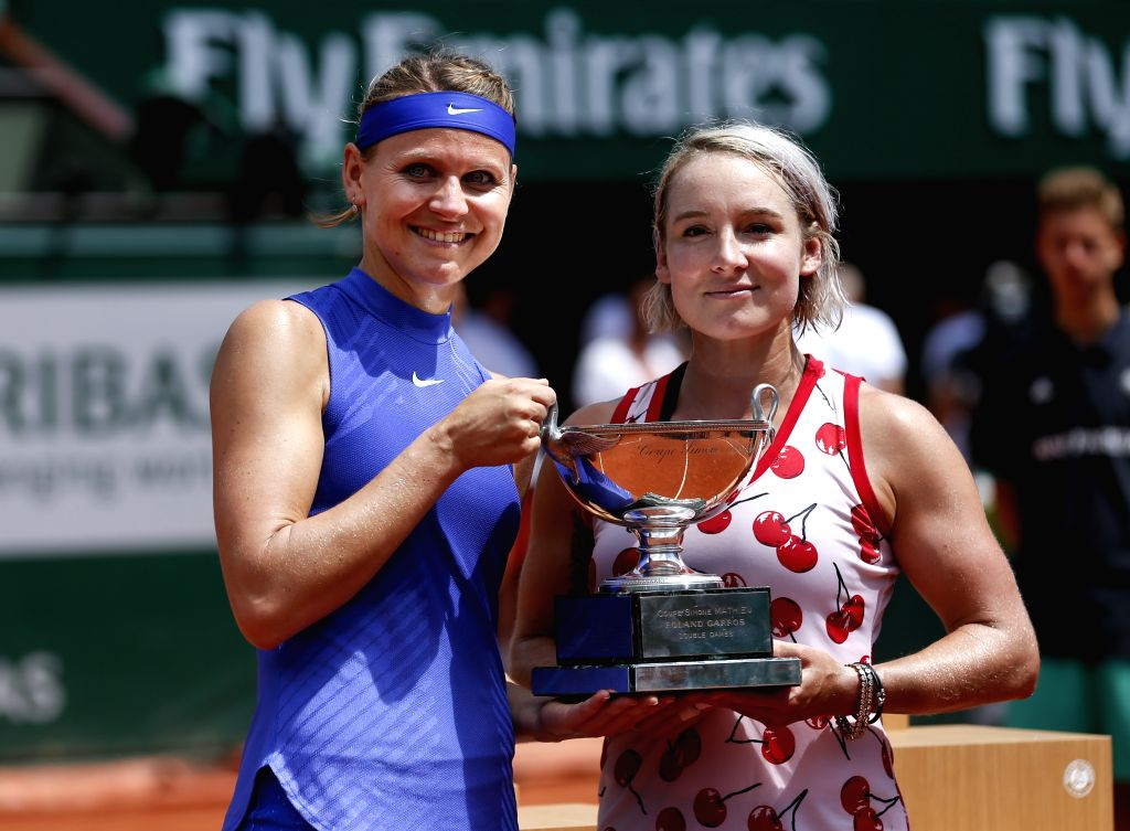 PARIS, June 11, 2017 - Lucie Safarova (L) of the Czech Republic and Bethanie Mattek-Sands of the United States hold their winners trophy after the women's doubles final with Ashleigh Barty/Casey ...