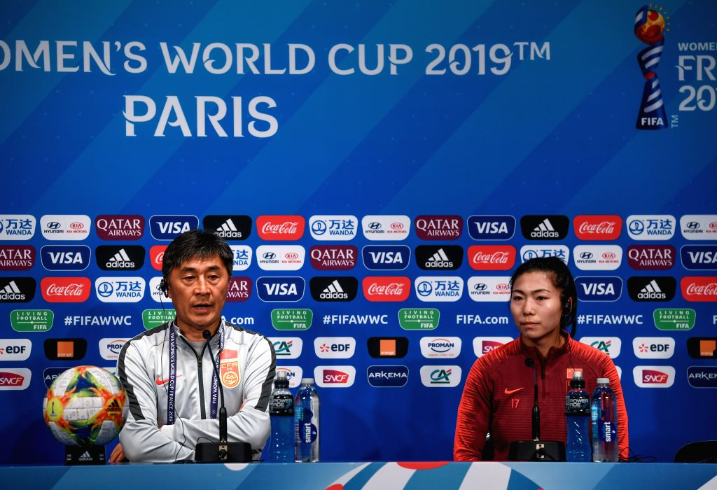 PARIS, June 12, 2019 - Head Coach Jia Xiuquan (L) and player Gu Yasha of China attend the official press conference one day ahead of the group B match between South Africa and China at the 2019 FIFA ...
