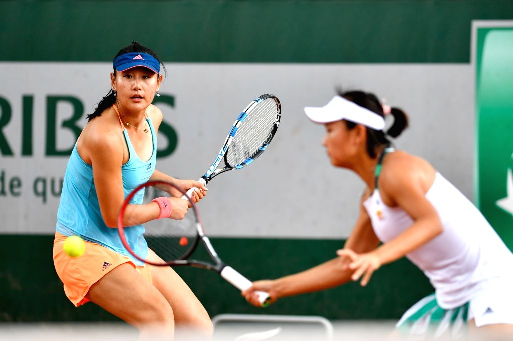 PARIS, June 2, 2017 - Duan Yingying(L)/Peng Shuai of China returns the ball to Daria Kasatkina/Irina Khromacheva of Russia during the women's doubles 2nd round match at the French Open Tennis ...