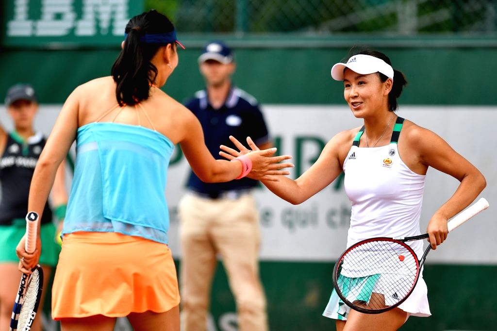 PARIS, June 2, 2017 - Duan Yingying/Peng Shuai(R) of China cheer each other during the women's doubles 2nd round match against Daria Kasatkina/Irina Khromacheva of Russia at the French Open Tennis ...