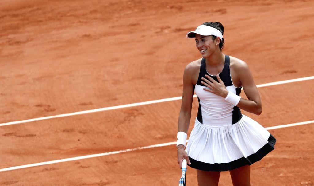 PARIS, June 2, 2017 - Garbine Muguruza of Spain celebrates after the women's singles third round match with Yulia Putintseva of Kazakhstan at French Open Tennis Tournament 2017 in Roland Garros, ...