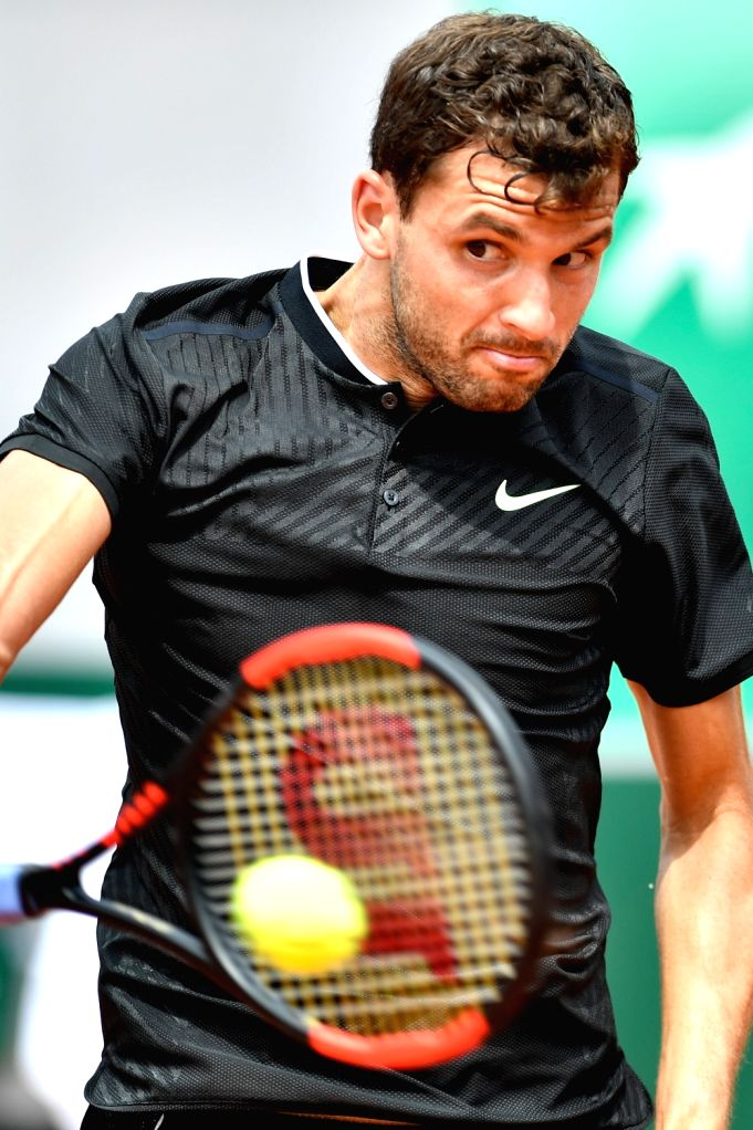 PARIS, June 2, 2017 - Grigor Dimitrov of Bulgaria returns the ball to Pablo Carreno Busta of Spain during the men's singles 3rd round match at the French Open Tennis Tournament 2017 in Paris, France ...