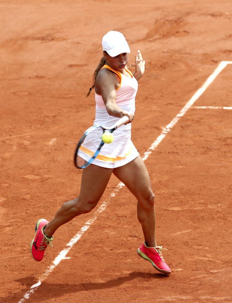 PARIS, June 2, 2017 - Yulia Putintseva of Kazakhstan competes during the women's singles third round match with Garbine Muguruza of Spain at French Open Tennis Tournament 2017 in Roland Garros, ...
