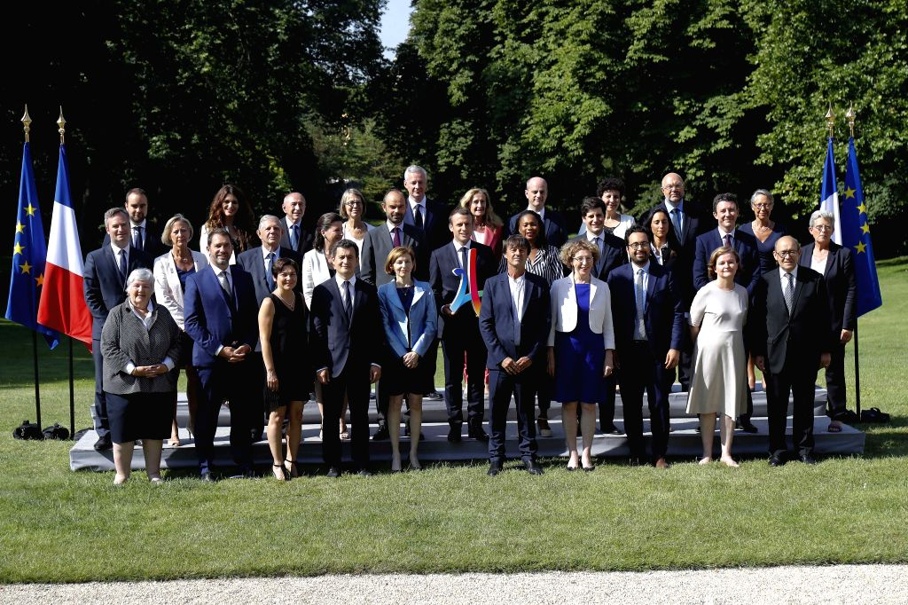 PARIS, June 22, 2017 - French President Emmanuel Macron (C) and new cabinet members pose for a group photo in the Elysee Palace in Paris, France, on June 22, 2017. French President Emmanuel Macron ...