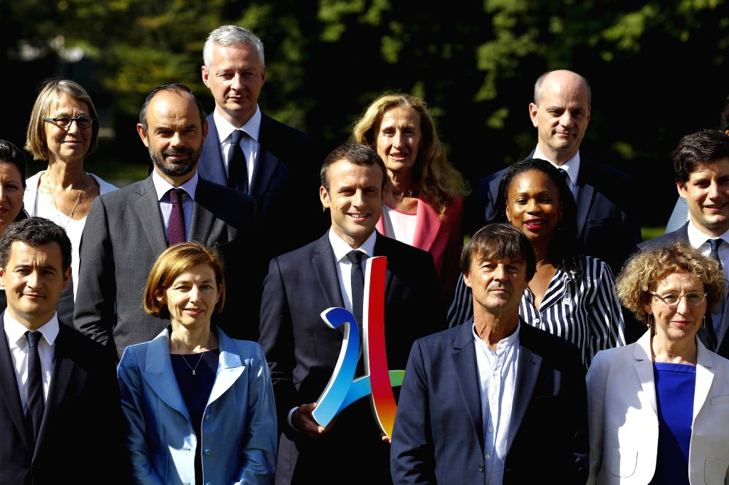 PARIS, June 22, 2017 - French President Emmanuel Macron (C) poses for a group photo with new cabinet members in the Elysee Palace in Paris, France, on June 22, 2017. French President Emmanuel Macron ...