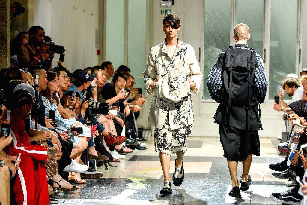 PARIS, June 23, 2017 - Models present the design of Yohji Yamamoto during Paris Men's Fashion Week Spring/Summer 2018 in Paris, France on June 22, 2017.