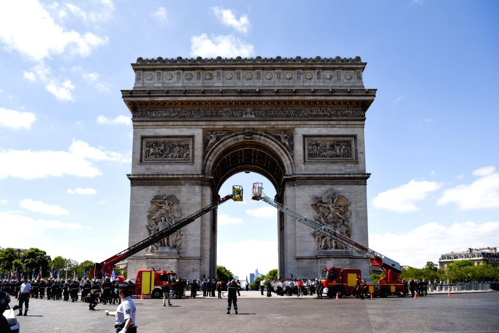 PARIS, June 24, 2017 - Firefighters and fire trucks are seen gathered under the Triumphal arch in commemoration of the national firefighters' day which falls on 23 and 24 of June in Paris, France on ...