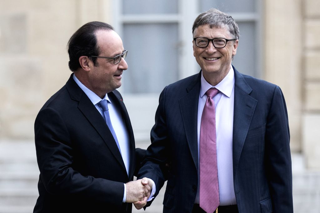 PARIS, June 27, 2016 - French President Francois Hollande (L) shakes hands with Microsoft co-founder and philanthropist Bill Gates following their meeting on June 27, 2016 at the Elysee Presidential ...