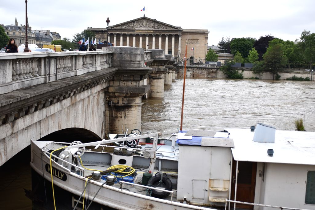 PARIS, June 3, 2016 - A barge is seen higher than the aperture of bridge due to the rising water level in Paris, France, June 3, 2016. Due to heavy rainfall across French cities, flood waters have ...