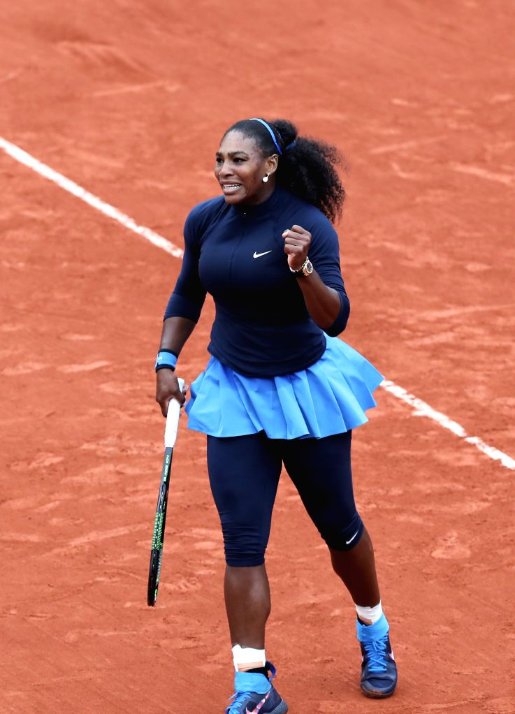 PARIS, June 3, 2016 - Serena Williams of the United States celebrates her victory over Yulia Putintseva of Kazakhstan during their women's singles quarterfinal of the French Open tennis tournament at ...