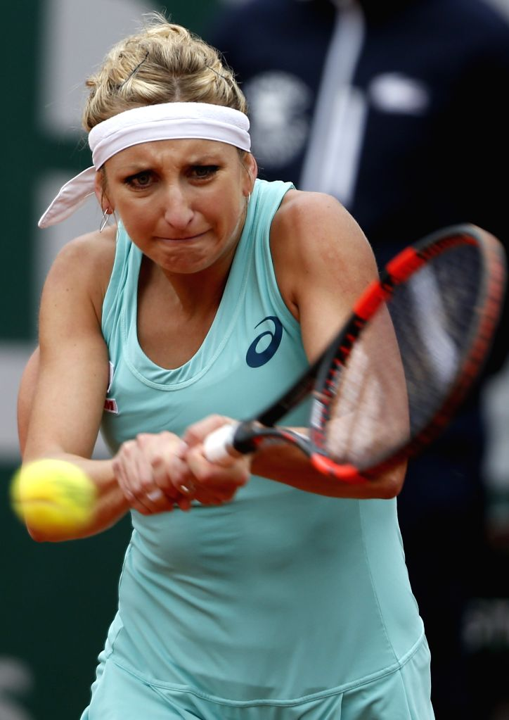 PARIS, June 3, 2016 - Timea Bacsinszky of Switzerland hits a return to Kiki Bertens of the Netherlands during their women's singles quarterfinal of the French Open tennis tournament at the Roland ...