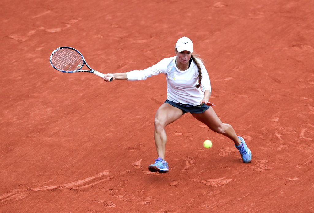 PARIS, June 3, 2016 - Yulia Putintseva of Kazakhstan hits a return to Serena Williams of the United States during their women's singles quarterfinal of the French Open tennis tournament at the Roland ...