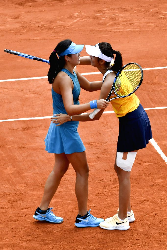 PARIS, June 3, 2018 - Chan Hao-Ching of Chinese Taipei and Yang Zhaoxuan (L) of China celebrate after winning the women's doubles third round match against Sorana Cirstea of Romania and Sara Sorribes ...