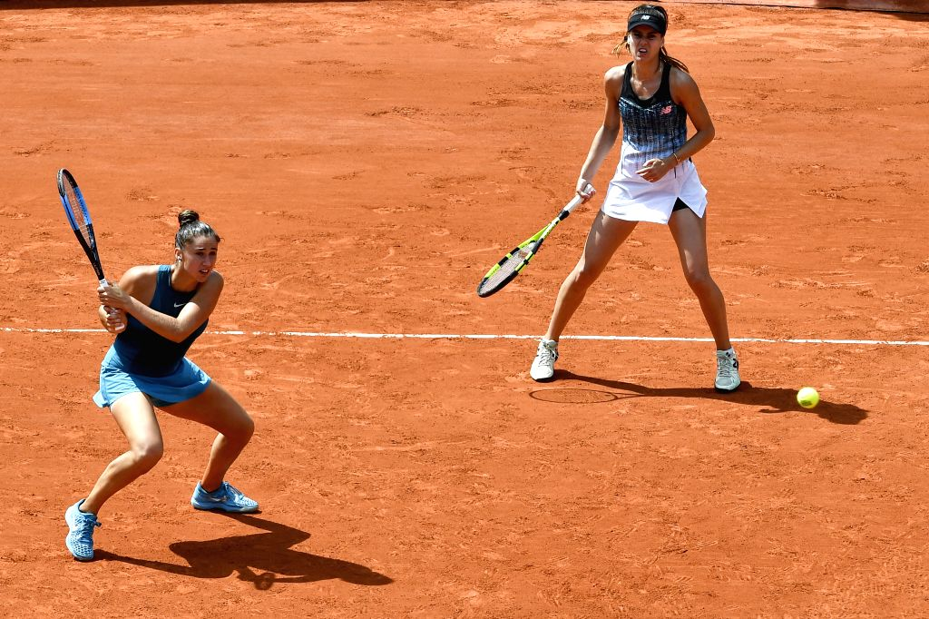 PARIS, June 3, 2018 - Sorana Cirstea of Romania and Sara Sorribes Tormo (L) of Spain return a shot during the women's doubles third round match against Chan Hao-Ching of Chinese Taipei and Yang ...