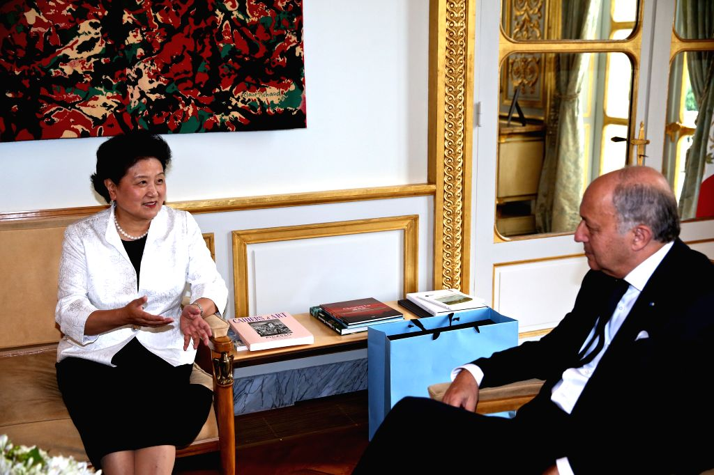 PARIS, June 30, 2016 - Chinese Vice Premier Liu Yandong (L) meets with President of France's Constitutional Council Laurent Fabius in Paris, France, June 29, 2016. (Xinhua/Jin Yu)
