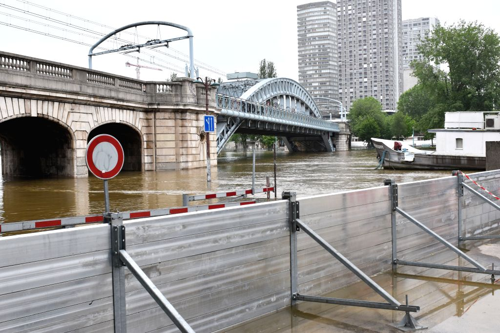 PARIS, June 4, 2016 - Rising Seine River water is fenced off in Paris, France, June 4, 2016. Death toll in floods that hit Paris and central French cities rose to four with 24 others wounded, French ... - Manuel Valls