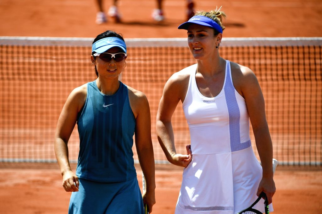 PARIS, June 4, 2018 - Gabriela Dabrowski of Canada and Xu Yifan (L) of China communicate during the women's doubles third round match against Eri Hozumi and Makoto Ninomiya of Japan at the French ...