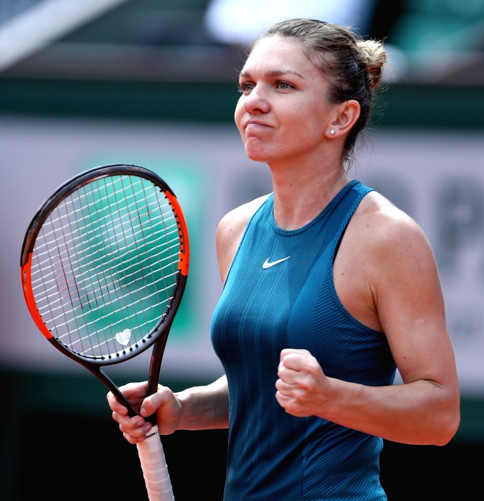 PARIS, June 4, 2018 - Simona Halep of Romania celebrates after winning the women's singles 4th round match against Elise Mertens of Belgium at the French Open Tennis Tournament 2018 in Paris, France ...