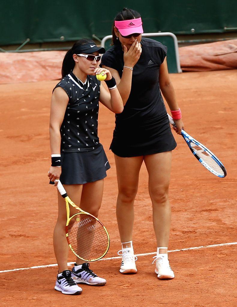 PARIS, June 4, 2019 - Duan Yingying/Zheng Saisai(L) of China react during the women's doubles quarterfinal match with Xu Yifan of China and Gabriela Dabrowski of Canada at French Open tennis ...