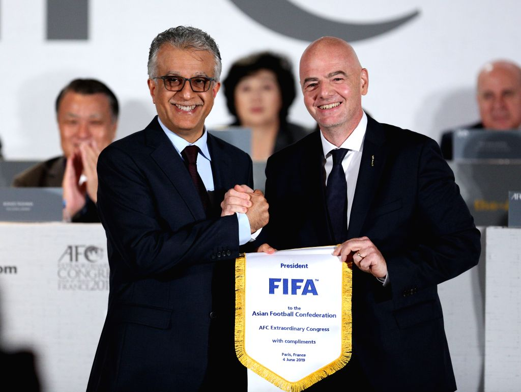 PARIS, June 4, 2019 (Xinhua) -- AFC President Shaikh Salman bin Ebrahim Al Khalifa (L) and FIFA President Gianni Infantino pose for photos during the AFC Extraordinary Congress in Paris, France, June 4, 2019. China was confirmed as the host of the AF