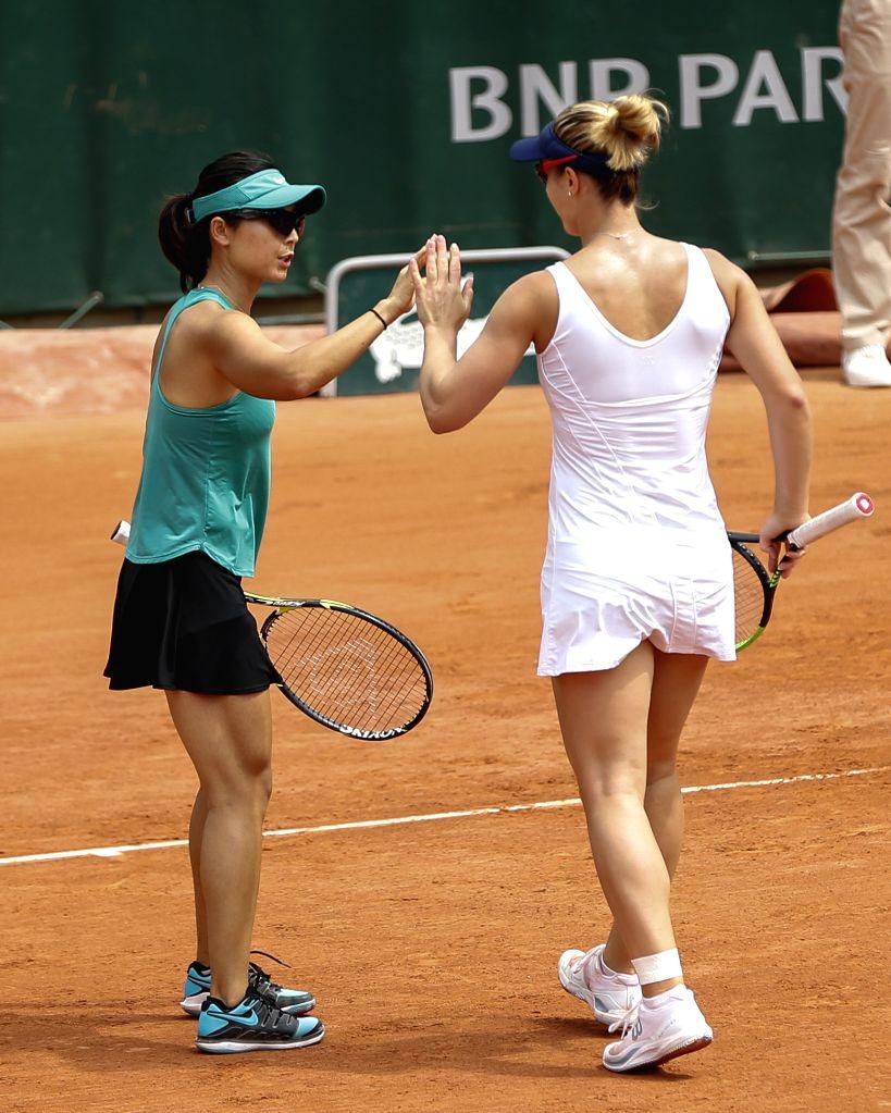 PARIS, June 4, 2019 - Xu Yifan (L) of China and Gabriela Dabrowski of Canada react during the women's doubles quarterfinal match with Duan Yingying/Zheng Saisai of China at French Open tennis ...