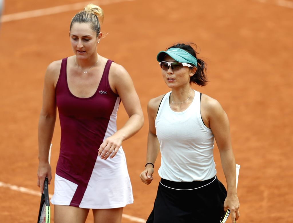 PARIS, June 4, 2019 - Xu Yifan (R) of China and Gabriela Dabrowski of Canada react during the women's doubles third round match with Fiona Ferro/Diane Parry of France at French Open tennis tournament ...