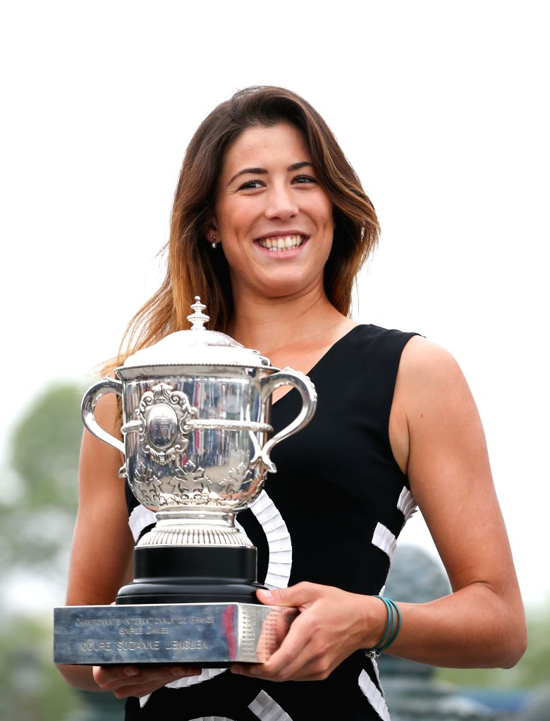 PARIS, June 5, 2016 - Spain's Garbine Muguruza poses with the French Open trophy at Place de la Concorde in Paris, France on June 5, 2016. Muguruza defeated Serena Williams of the United States ...
