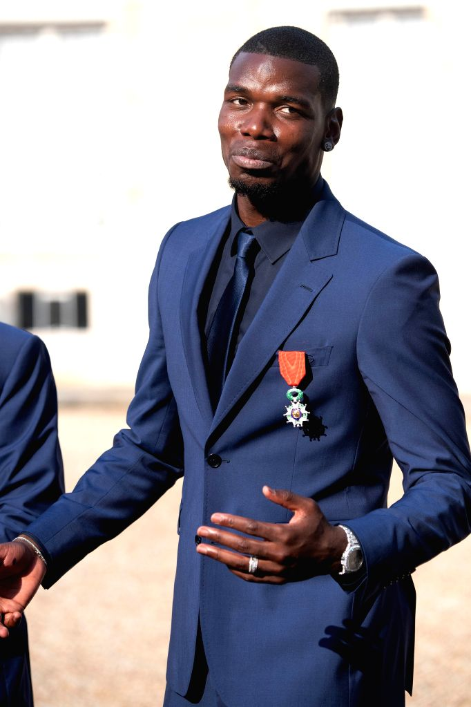 PARIS, June 5, 2019 - French soccer team player Paul Pogba, winner of the Russia 2018 World Cup, leaves after being awarded with France's prestigious Legion of Honour during a ceremony at the Elysee ...