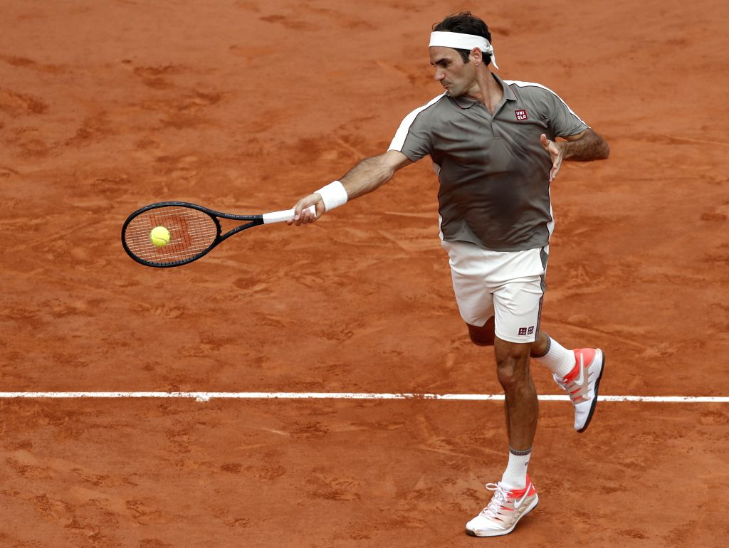PARIS, June 5, 2019 (Xinhua) -- Roger Federer of Switzerland competes during the men's singles quarterfinal match against his compatriot Stan Wawrinka at French Open tennis tournament 2019 at Roland Garros, in Paris, France on June 4, 2019. Roger Fed