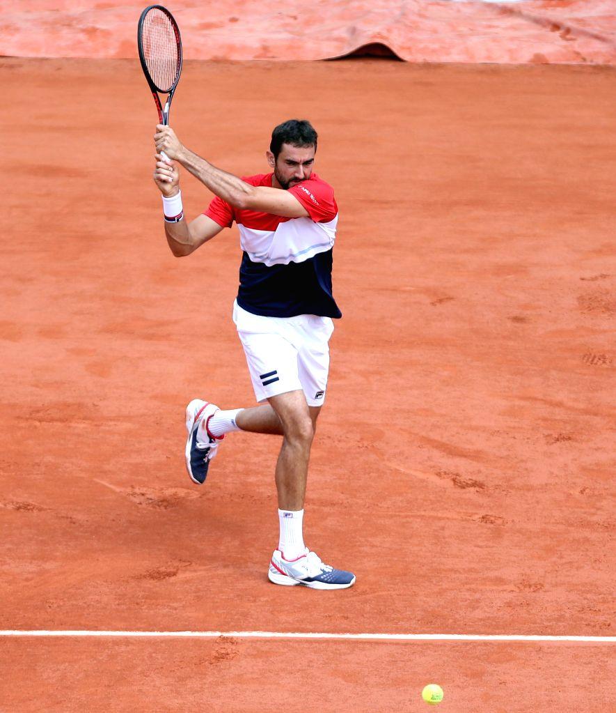 PARIS, June 7, 2018 - Marin Cilic of Croatia returns the shot during the men's singles quarterfinal match against Juan Martin Del Potro of Argentina at the French Open Tennis Tournament 2018 in ...