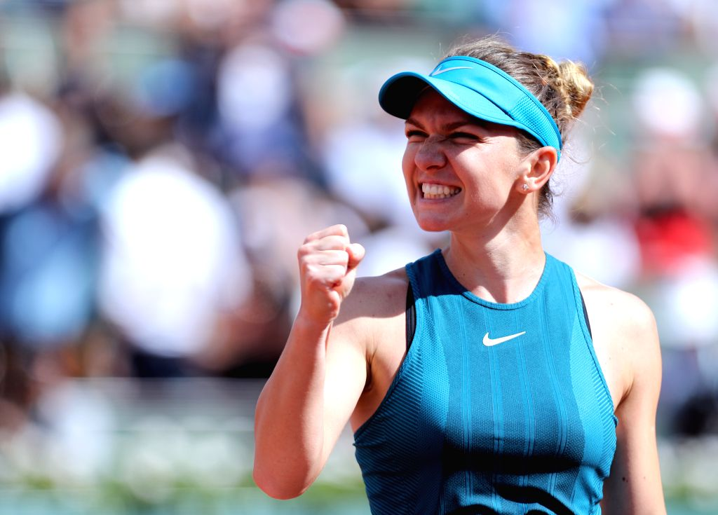 PARIS, June 7, 2018 - Simona Halep of Romania celebrates after the women's singles semifinal match against Garbine Muguruza of Spain at the French Open Tennis Tournament 2018 in Paris, France on June ...