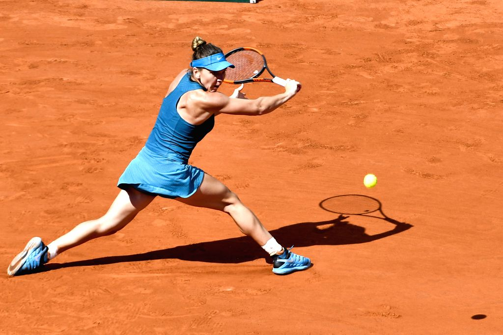 PARIS, June 7, 2018 - Simona Halep of Romania hits a return during the women's singles semifinal match against Garbine Muguruza of Spain at the French Open Tennis Tournament 2018 in Paris, France on ...