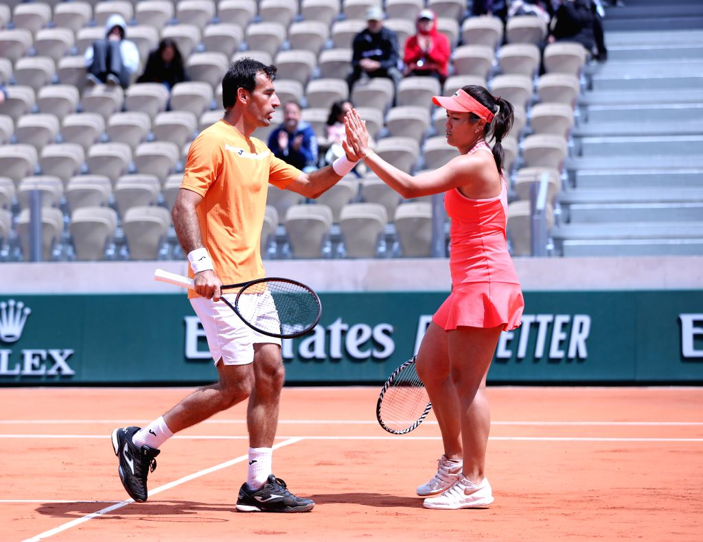 PARIS, June 7, 2019 - Latisha Chan(R) of Chinese Taipei and Ivan Dodig of Croatia celebrate during the mixed doubles final match against Gabriela Dabrowski of Canada and Mate Pavic of Croatia at ...