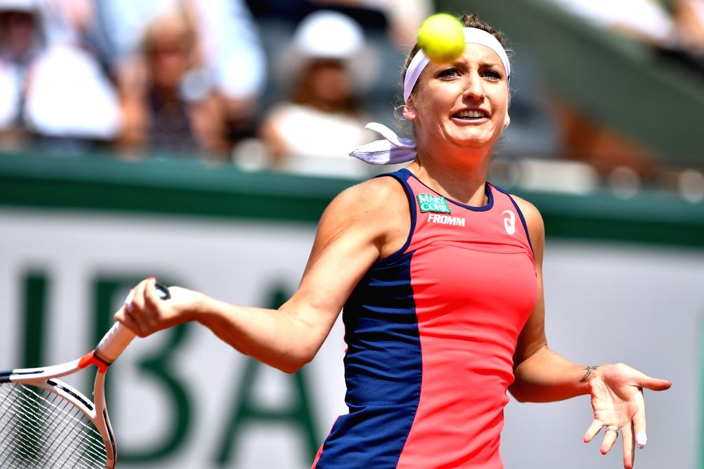 PARIS, June 9, 2017 - Timea Bacsinszky of Switzerland returns the ball during the women's singles semifinal against Jelena Ostapenko of Latvia at the 2017 French Open Tennis Tournament in Paris, ...