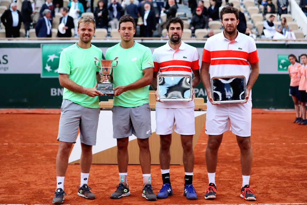 PARIS, June 9, 2019 - Kevin Krawietz (L)/Andreas Mies of Germany and Jeremy Chardy/Fabrice Martin of France pose for photos during the awarding ceremony after men's doubles final at the 2019 French ...