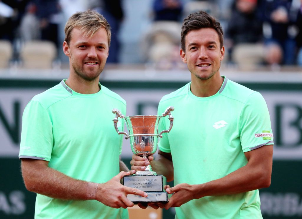 PARIS, June 9, 2019 - Kevin Krawietz (L)/Andreas Mies of Germany pose with the trophy during the awarding ceremony after men's doubles final against Jeremy Chardy/Fabrice Martin of France at the 2019 ...