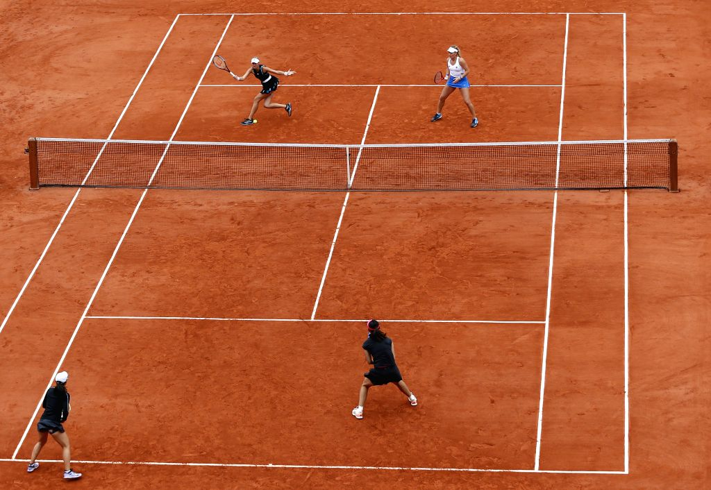 PARIS, June 9, 2019 (Xinhua) -- Timea Babos(Top R) of Hungary and Kristina Mladenovic(Top L) of France compete during the women's doubles final with Duan Yingying/Zheng Saisai of China at French Open tennis tournament 2019 at Roland Garros, in Paris,