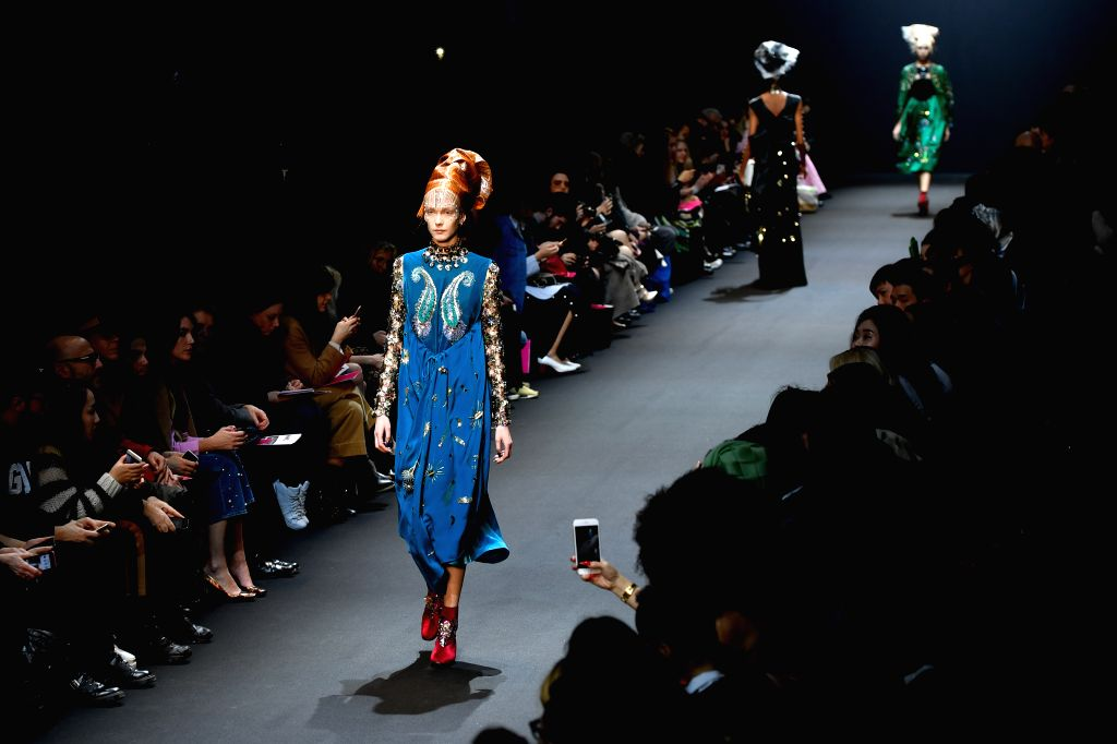 PARIS, March 2, 2017 - Models present creations of Manish Arora during the Women's Ready-to-Wear Fall Winter 2017/2018 fashion week in Paris, France, on March 2, 2017. - Manish Arora