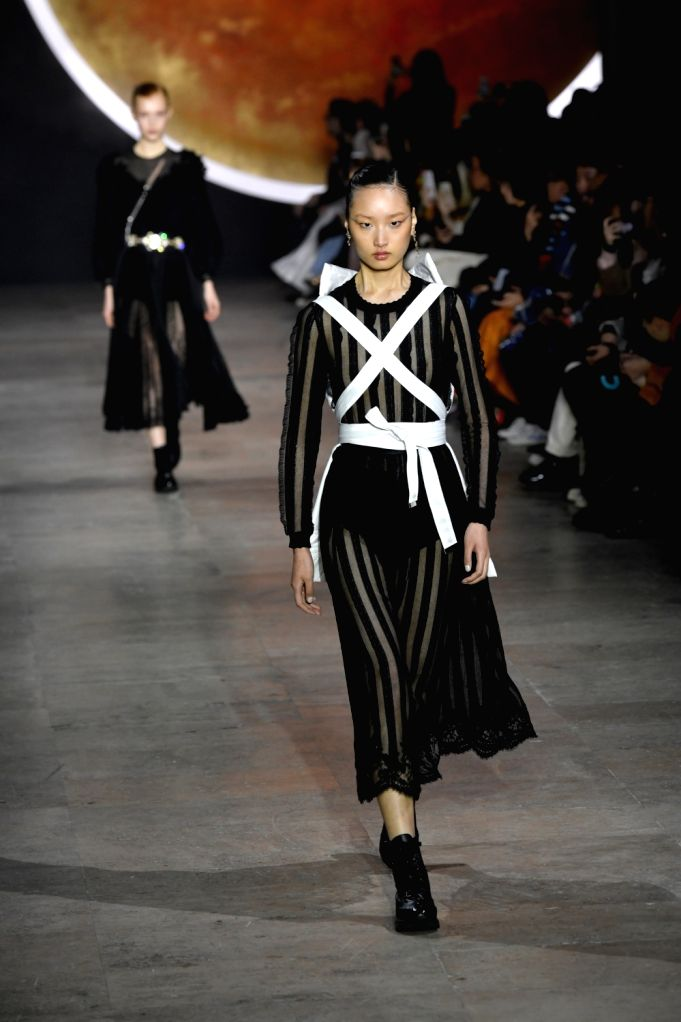 PARIS, March 5, 2019 - A model presents a creation of Shiatzy Chen for its Fall-Winter 2019/2020 Ready-to-Wear collection during Paris Fashion Week in Paris, France, March 4, 2019.