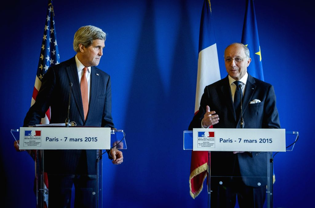 U.S. Secretary of State John Kerry (L) and French Foreign Minister Laurent Fabius attend a press conference in Paris, France, on March 7, 2015. U.S. Secretary of ... - Laurent Fabius