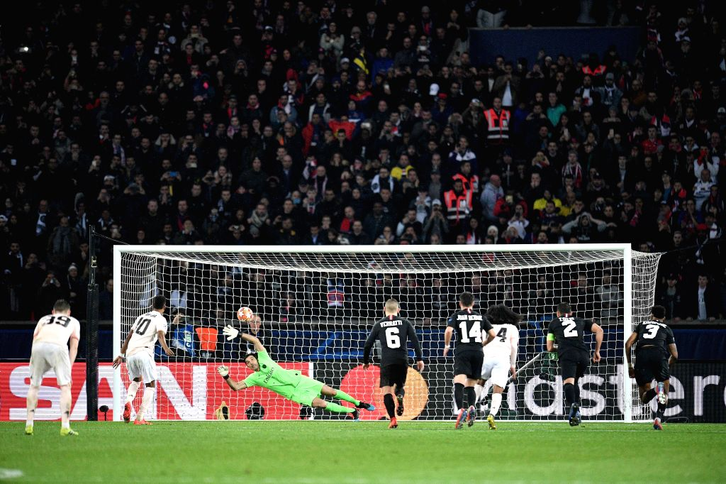 PARIS, March 7, 2019 - Marcus Rashford (2nd L) of Manchester United scores his team's third goal from the penalty spot past Gianluigi Buffon (3rd L), goalie of Paris Saint-Germain during the UEFA ...