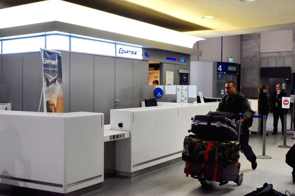 PARIS, May 19, 2016 - A passenger passes by the counter of EgyptAir in Paris Charles de Gaulle Airport, France, May 19, 2016. A crisis center was set up early Thursday morning at Terminal 1 of Paris ...