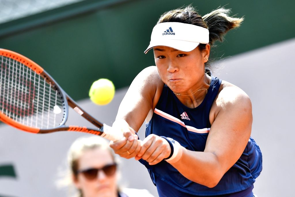 PARIS, May 22, 2018 - Han Xinyun of China returns the ball to Nicole Gibbs of the United States during the women's singles Qualification 1st round match of French Open in Paris, France on May 22, ...