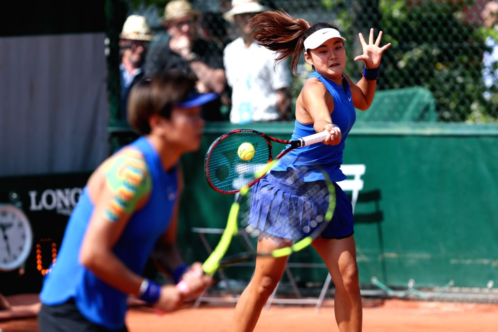 PARIS, May 27, 2016 - Liang Chen and Wang Yafan (R) of China compete during the women's doubles second round match against Barbora Krejcikov and Katerina Siniakova of the Czech Republic on day 6 of ...
