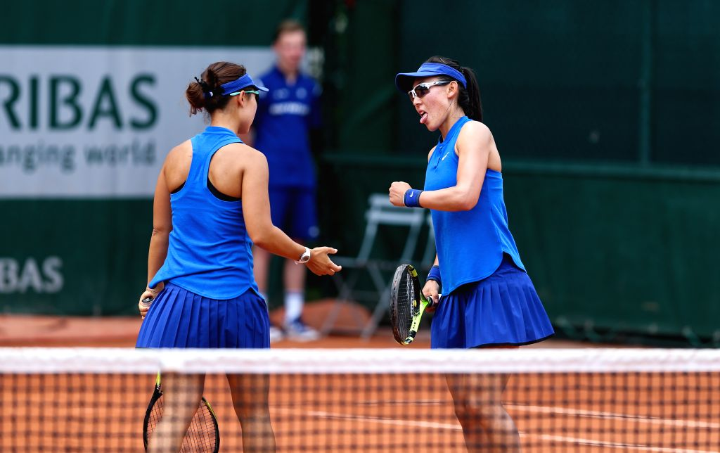 PARIS, May 27, 2016 - Xu Yifan/Zheng Saisai(R) of China react during the women's doubles second round match with Sabine Lisicki/Andrea Petkovic of Germany on day 6 of 2016 French Open tennis ...