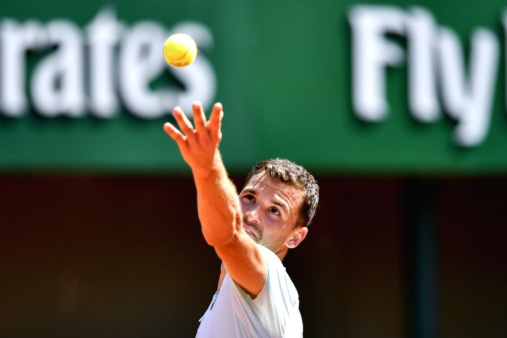 PARIS, May 27, 2018 - Grigor Dimitrov of Bulgaria serves during the men's singles first round match against Mohamed Safwat of Egypt at the French Open Tennis Tournament 2018 in Paris, France on May ...