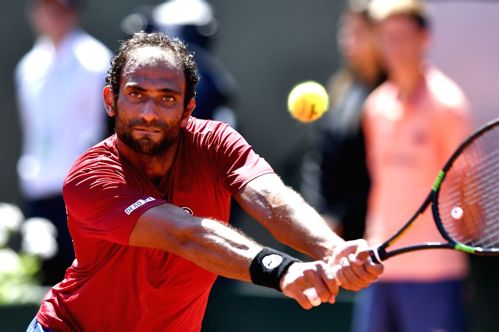 PARIS, May 27, 2018 - Mohamed Safwat of Egypt returns a shot during the men's singles first round match against Grigor Dimitrov of Bulgaria at the French Open Tennis Tournament 2018 in Paris, France ...