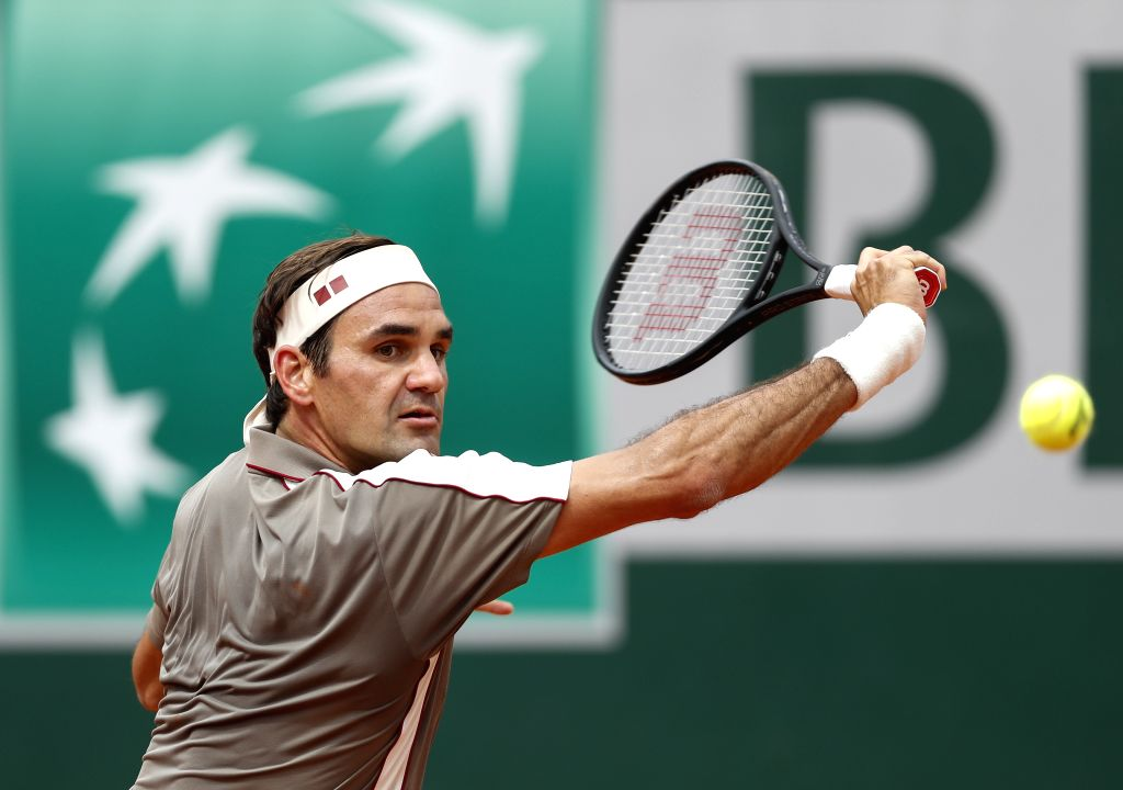 PARIS, May 27, 2019 - Roger Federer of Switzerland hits a return during the men's singles first round match against Lorenzo Sonego of Italy at French Open tennis tournament 2019 in Paris, France on ...