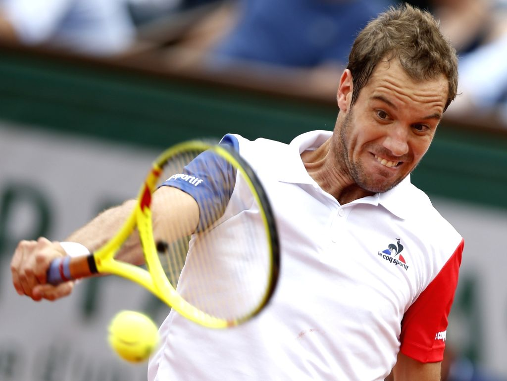 PARIS, May 28, 2016 - Richard Gasquet of France returns the ball during the men's single third round match against Nick Kyrgios of Australia at the French Open tennis tournament at Roland Garros in ...